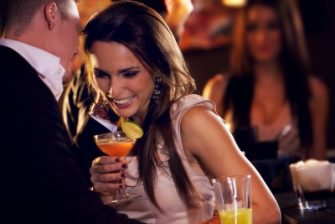 man-flirting-with-woman-at-bar