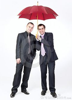 two-businessmen-standing-under-umbrella-19914129